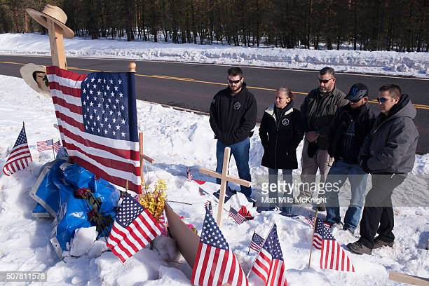 Members of the Idaho Three Percenters patriot group gather at the site where LaVoy Finicum was shot and killed by federal agents on January 26...