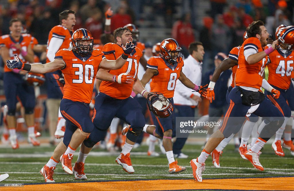 Members of the Illinois Fighting Illini celebrate after defeating the Nebraska Cornhuskers at Memorial Stadium on October 3, 2015 in Champaign, Illinois. Illinois defeated Nebraska 14-13.