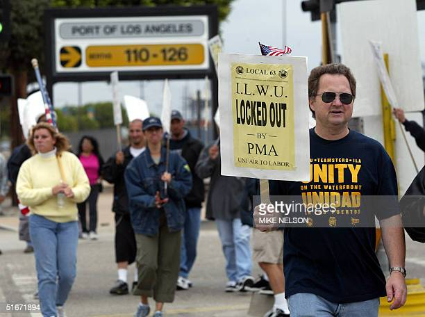 Members of the ILWU picket outside the Port of Los Angeles as the lock out of dock workers continues into its second day 01 October 2002 Twentynine...