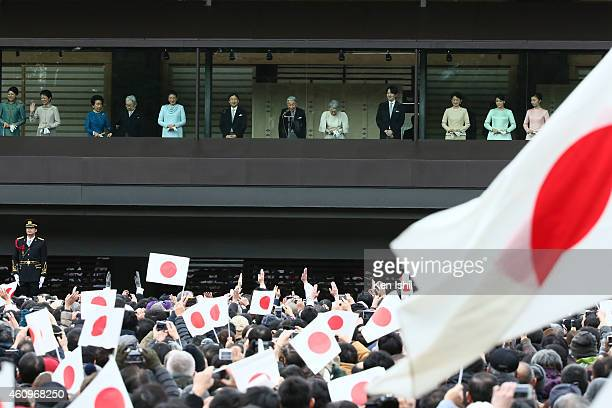 Members of the Imperial family wave to wellwishers during the celebration for the New Year on the veranda of the Imperial Palace on January 2 2015 in...
