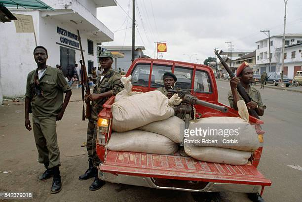 Members of the Independent National Patriotic Front of Liberia patrol the streets of Monrovia Responding to years of government corruption and...