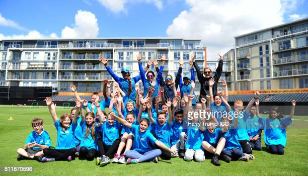 Members of the India side Charlotte Edwards and Schoolchildren pose for a photo during the Cricket for Good India event at The County Ground on July...