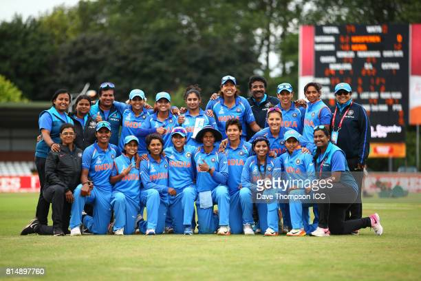 Members of the India squad pose for a photograph during the ICC Women's World Cup match between India and New Zealand at The 3aaa County Ground on...