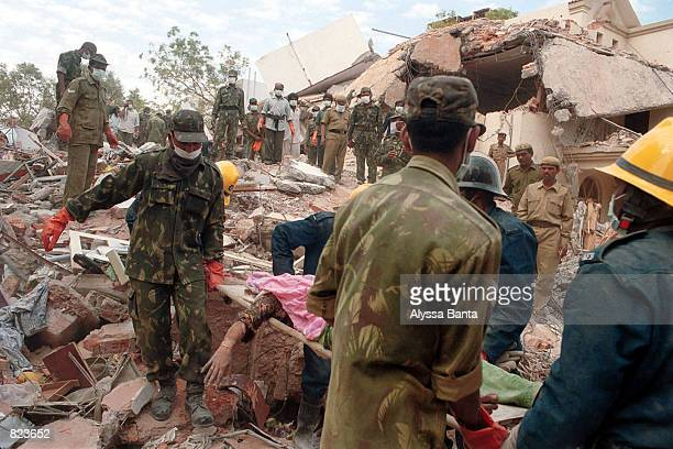 Members of the Indian Army aid in the clearing of rubble and the unearthing of earthquake victims January 30 2001 in the town of Ahmedabad India...