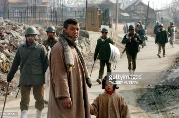 Members of the Indian Central Reserve Police Force patrol downtown after overnight sectarian clashes in Srinagar 20 January 2008 Indian police used...