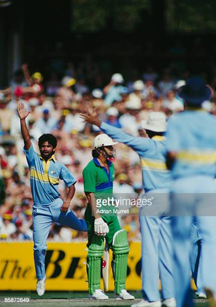 Members of the Indian cricket team celebrate taking the wicket of Imran Khan during a match against Pakistan at Melbourne during the World...
