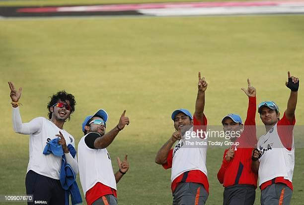 Members of the Indian cricket team enjoying during practice session ahead of their match against the Netherlands at the Ferozeshah Kotla Stadium in...