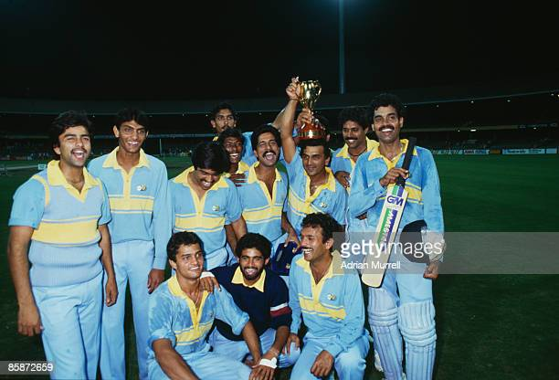 Members of the Indian cricket team with the trophy after their victory over Pakistan in the final of the World Championship of Cricket One Day...