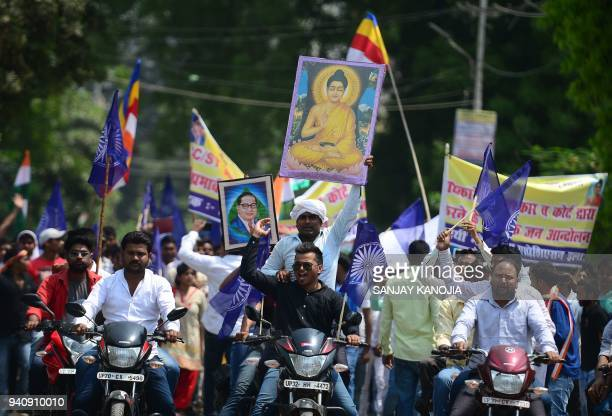 Members of the Indian Dalit community stage a protest during a countrywide strike against a Supreme Court order that allegedly diluted the Scheduled...