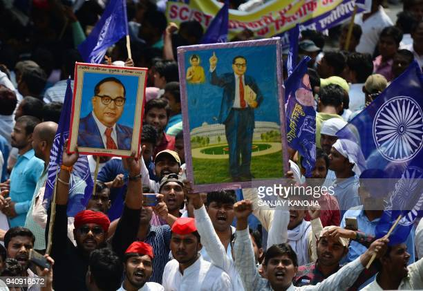 Members of the Indian Dalit community stage a protest, with portraits of 20th century social reformer B. R. Ambedkar, during a countrywide strike...