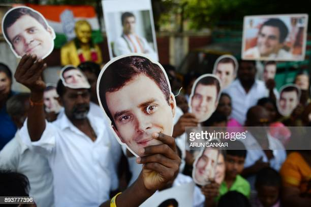 TOPSHOT Members of the Indian National Congress party celebrate as they display masks of the newlyelected party President Rahul Gandhi in Chennai on...