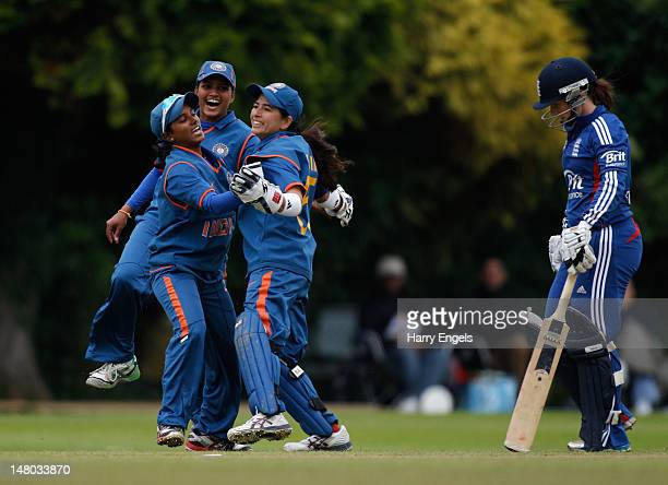 Members of the Indian team celebrate after dismissing Tammy Beaumont of England during the 4th NatWest International One Day match between England...