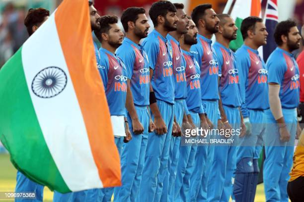 Members of the Indian team line up for the national anthems during the third Twenty20 international cricket match between New Zealand and India in...
