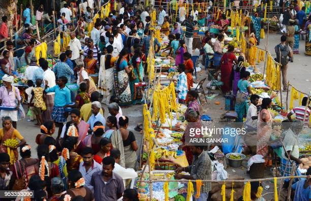 Members of the Indian transgender community and other devotees gather at a festival at the Koothandavar Temple in the village of Koovagam in the...