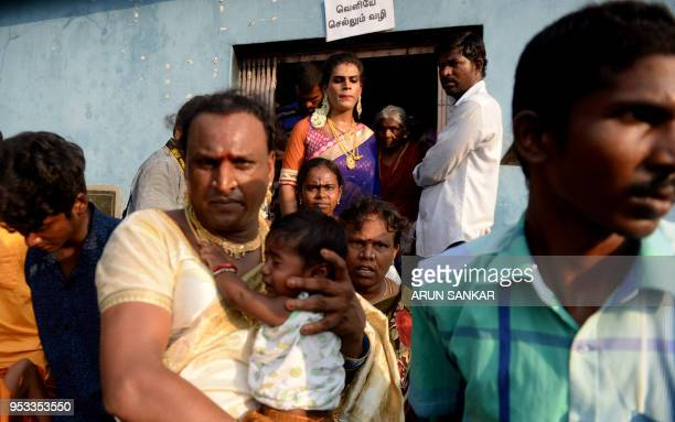 Members of the Indian transgender community dressed as brides take part in a 'thali' ritual signifying marriage to the Hindu warrior god Aravan at...