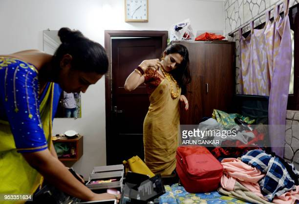 Members of the Indian transgender community prepare to travel to a festival at the Koothandavar Temple in the village of Koovagam in the southern...
