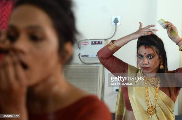 Members of the Indian transgender community prepares to travel to a festival at the Koothandavar Temple in the village of Koovagam in the southern...