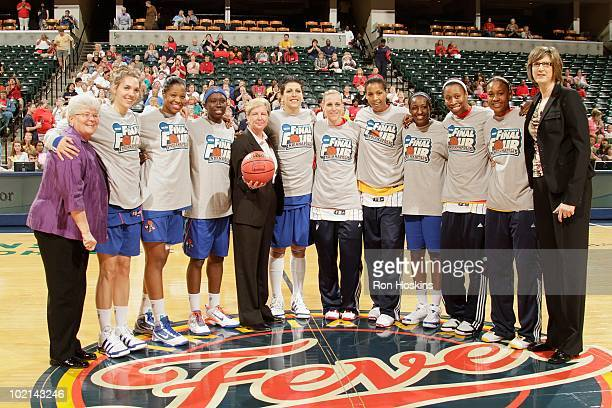 Members of the Indiana Fever and New York Liberty pose with Fever head coach Lin Dunn and Liberty head coach Anne Donovan prior to a game at Conseco...