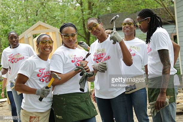 Members of the Indiana Fever have some fun as the Fever participated in a Habitat for Humanity build on May 17 2013 in Indianapolis Indiana NOTE TO...