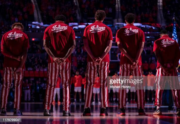 Members of the Indiana Hoosiers are seen during the National Anthem before the game against the Illinois Fighting Illini at State Farm Center on...