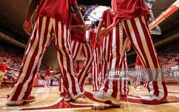 Members of the Indiana Hoosiers are seen sporting their traditional Adidas candystripe warmups before the game against the Eastern Michigan Eagles at...