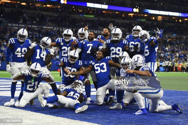 Members of the Indianapolis Colts celebrate after Bobby Okereke returns a two point conversion during a game against the Jacksonville Jaguars at...