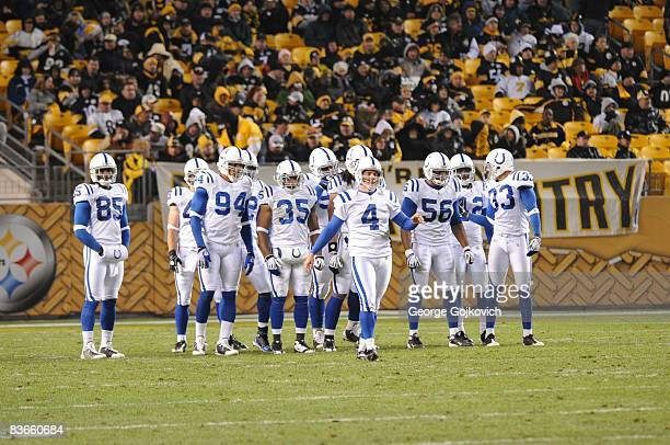 Members of the Indianapolis Colts kickoff team, including Pierre Garcon, Curtis Johnson, Chad Simpson, Tyjuan Hagler and Melvin Bullitt, gather...