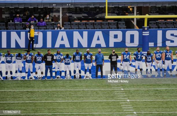 Members of the Indianapolis Colts some wearing shirts that say Black Lives Matter line up during pregame ceremonies before the game against the...