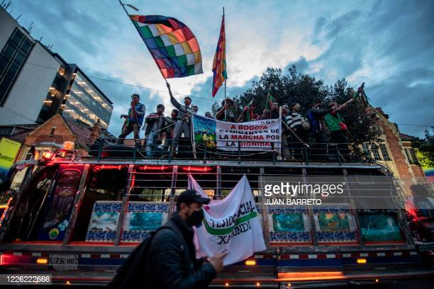 Members of the indigenous guard joined by union workers protest against Colombian President Ivan Duque and the alleged rape of indigenous girls by...