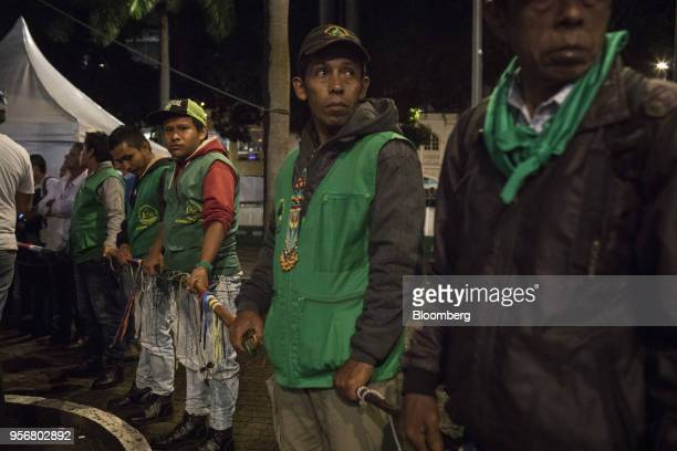 Members of the Indigenous Guard secure the Bolivar Square perimeter as Gustavo Petro presidential candidate for the Progressivists Movement Party...