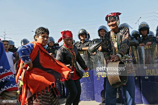 Members of the indigenous Lumad tribe from the southern Philippines perform a traditional dance to express their protest against the Asia Pacific...