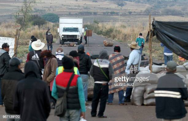 Members of the indigenous Wixaritari communities from Bolanos municipality block a road during a protest against the four political parties and their...