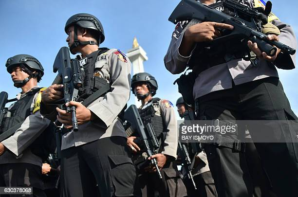 Members of the Indonesian bombsquad police unit take part in a roll call in Jakarta on December 22 as part of efforts to secure Christmas and New...