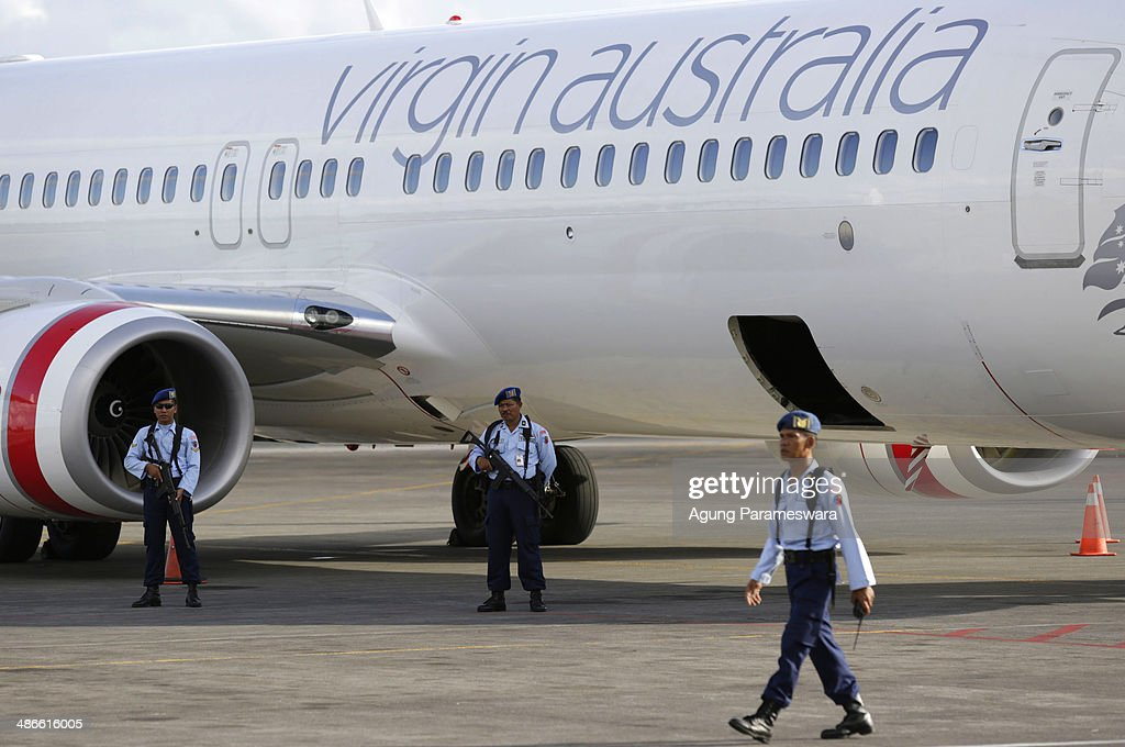 Members of the Indonesian military stands guard near a Virgin Australia airplane, which was forced to land at International Ngurah Rai Airport after the pilot sent a distress signal on April 25, 2014 near Denpasar, Bali, Indonesia. Early reports suggested an attempt to hijack a Virgin Australia had occured mid-flight, although Virgin has since clarified that the disturbance was caused by a drunk passenger acting aggressively and attempting to enter the cockpit.