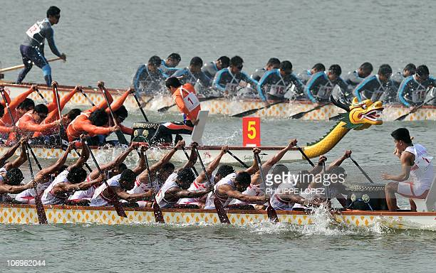 Members of the Indonesian South Korea and Thailand teams compete in the men's 500m dragon boat straight race at the 16th Asian Games in Guangzhou on...