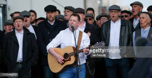 Members of the Infant Hercules Choir led by singer Mike McGrother perform as they travel across the River Tees on the Transporter Bridge Gondola as...