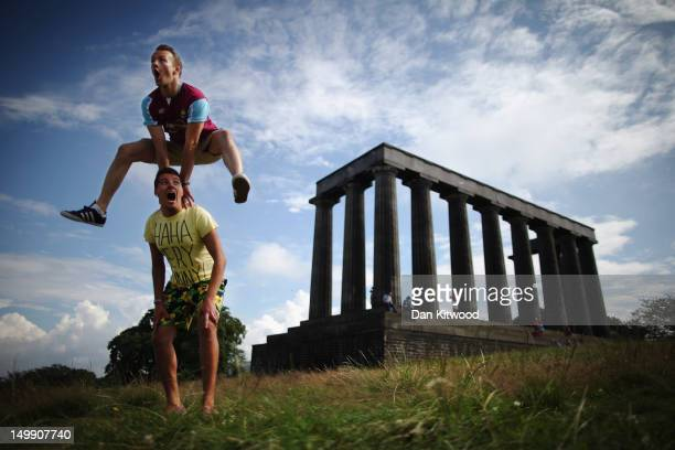 Members of the InSTEP theatre group take part in a photocall on Calton Hill to promote their show at the Edinburgh Fringe, 'Departure Lounge,' on...