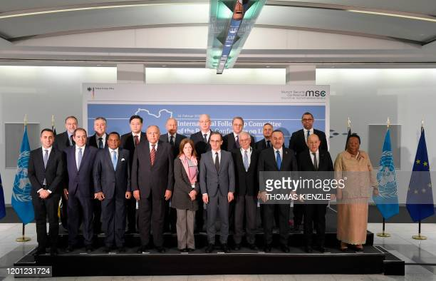 Members of the international committee pose for a family photo during a followup meeting on Libya arranged by German Foreign Minister Heiko Maas on...