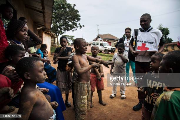 Members of the International Federation of the Red Cross and the Congolese Red Cross go door-to-door in the Beni neighbourhoods, northeastern...