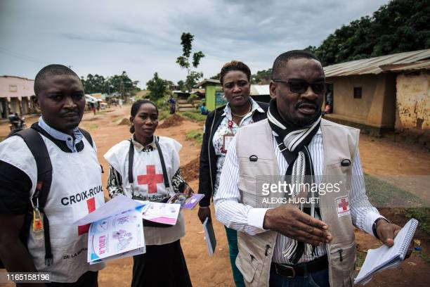 Members of the International Federation of the Red Cross and the Congolese Red Cross go door-to-door in the Beni neighbourhoods, northeastern...