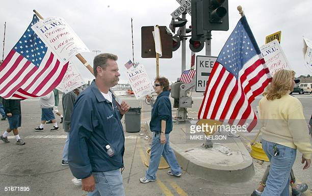 Members of the International Longshore and Warehouse Union picket outside the Port of Los Angeles as the lockout of dockworkers continues into the...