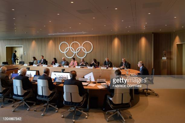 Members of the International Olympic Committee executive board take part in the opening of their meeting at the IOC headquarters in Lausanne on March...