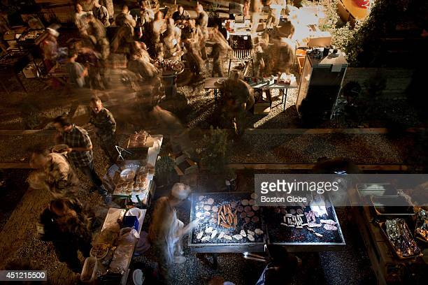 Members of the International Security Assistance Force cooked foods typical to their home countries during a barbecue at an International Security...
