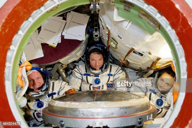 Members of the International space crew US astronaut Barry Wilmore and Russia's cosmonauts Alexandr Samokutyaev and Elena Serova attend a training...