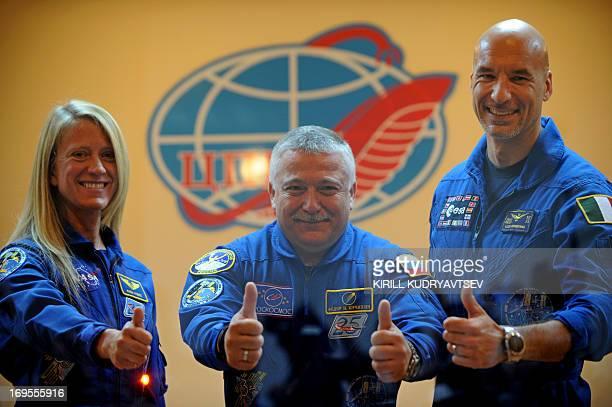 Members of the International space crew US astronaut Karen Nyberg Russian cosmonaut Fyodor Yurchikhin and European Space Agency Italian astronaut...