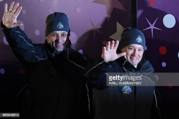Members of the International Space Station expedition 53/54 NASA astronaut Scott Tingle and Roscosmos cosmonaut Anton Shkaplerov wave from a bus...