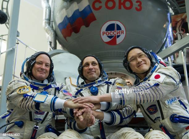 Members of the International Space Station expedition 54/55 NASA astronaut Scott Tingle Roscosmos cosmonaut Anton Shkaplerov and Norishige Kanai of...