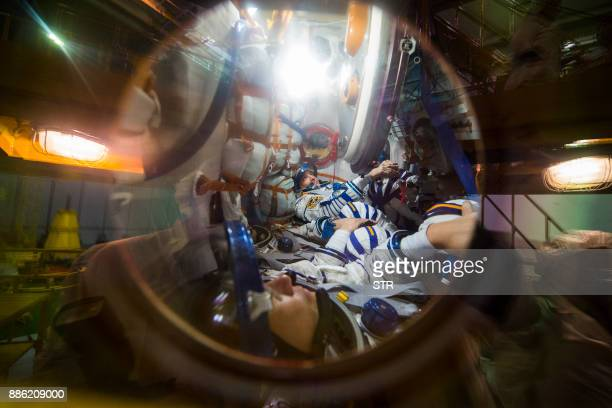 TOPSHOT Members of the International Space Station expedition 54/55 NASA astronaut Scott Tingle Roscosmos cosmonaut Anton Shkaplerov and Norishige...