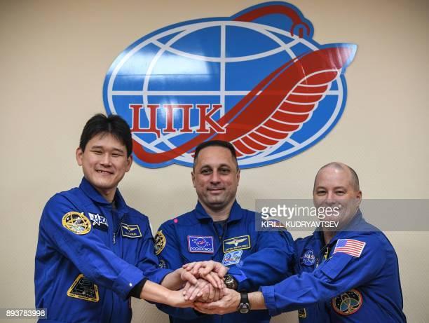 Members of the International Space Station expedition 54/55 Scott Tingle of NASA Anton Shkaplerov of Roscosmos and Norishige Kanai of the Japan...