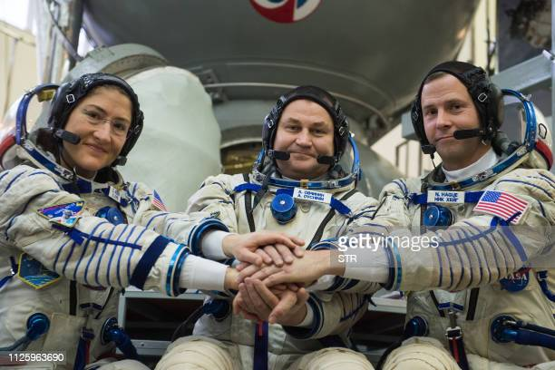 Members of the International Space Station expedition 59/60 NASA astronauts Christina Hammock Koch and Nick Hague and Russian cosmonaut Alexey...